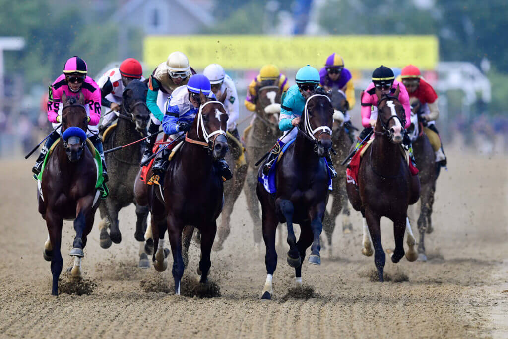Runners come down the straight in the 2019 Preakness Stakes