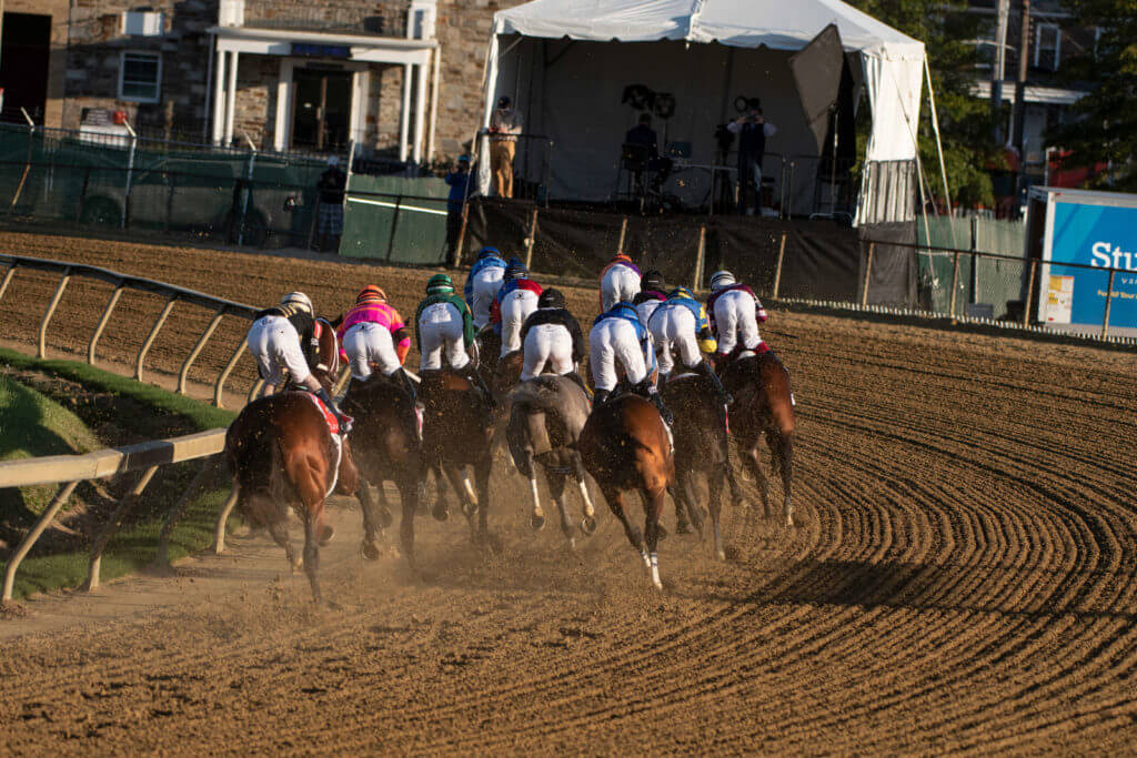 Horses exit turn one during the running of the 145 Preakness Stakes at Pimlico Race Course.